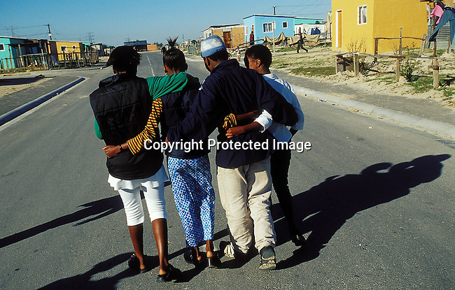 LSTEENA30008.Lifestyle. Teenager. Young teenagers walking down the street with their arms around each other. Love. Socialising. relaxed. RDP.99.©Per-Anders Pettersson/iAfrika Photos