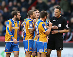 Shrewsbury players complain to referee Darren Deadman during the English League One match at the Bramall Lane Stadium, Sheffield. Picture date: November 19th, 2016. Pic Simon Bellis/Sportimage
