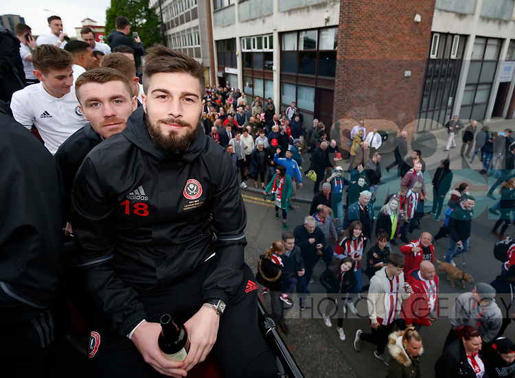 John Fleck of Sheffield Utd  and Kieron Freeman of Sheffield Utd during the open top bus parade from Bramall Lane Stadium to Sheffield Town Hall, Sheffield. Picture date: May 2nd 2017. Pic credit should read: Simon Bellis/Sportimage