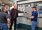 Illinois Governor Bruce Rauner visited Mac Medical in Millstadt, Illinois on Friday March 23 as part of his statewide tour to kick off his general election campaign. Rauner toured the facility, which manufactures medical equipment in its 100,000 square foot facility. Here, Rauner fist-bumps Mac Medical employee Mike Pierson (far right) of Dupo, Illinois, after they stopped at his workstation. Also shown is Mac Medical owner Dennis Cooper (far left) and Illinois State Senator Paul Schimpf, 58th District, from Waterloo who is behind Rauner. The machine is a panel bender, Person is an operator.