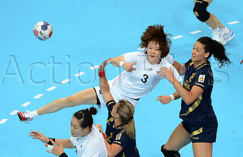 28.07.2012. London, England. Kim ON A C of South Korea Passes The Ball during the Womens Handball Preliminary Round Group B Match Against Spain in London 2012 Olympic GamesSouth Korea Won 31 27