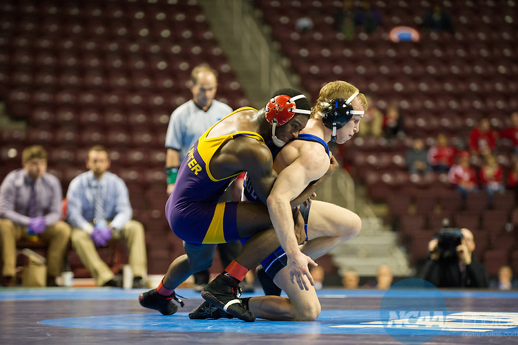 14 MAR 2015:  Cary Palmer of Hunter College (left) and Luther College's Drew Van Anrooy wrestle in the 141 pound championship match at the Division III Men's Wrestling Championship held at the Giant Center in Hershey, PA.  Ken Reabe Jr/NCAA Photos