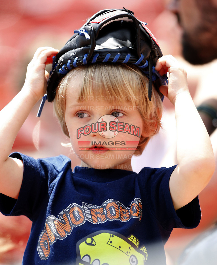 May 23, 2009:  A young fan finds new use for his glove during a game at Coca-Cola Field in Buffalo, NY.  Photo by:  Mike Janes/Four Seam Images
