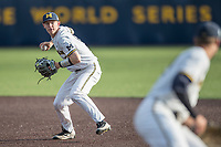 Michigan Wolverines second baseman Jimmy Kerr (15) prepares to make a throw to first base during the NCAA baseball game against the Eastern Michigan Eagles on May 16, 2017 at Ray Fisher Stadium in Ann Arbor, Michigan. Michigan defeated Eastern Michigan 12-4. (Andrew Woolley/Four Seam Images)