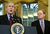 United States President George W. Bush discusses the Protect America Act in the Oval Office of the White House in Washington,, DC on February 13, 2008.  Looking on is the Director of National Intelligence (DNI) Michael McConnell. <br /> Credit: Kristoffer Tripplaar / Pool via CNP