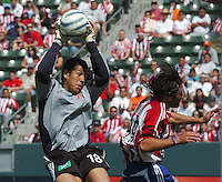 D. C. United's Nick Rimando, and Chivas' Thiago Martins at the Home Depot Center, in Carson, California, Saturday, April 2, 2005.