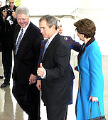 "Washington, DC January 20, 2001 -- United States President-elect George W. Bush gives a ""thumbs-up"" as he is escorted into his new home, The White House, by United States President Bill Clinton for a reception prior to going to the United States Capitol for the swearing-in ceremony.  First lady Senator Hillary Rodham Clinton (Democrat of New York) and Laura Bush follow..Credit: Ron Sachs / CNP"