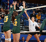 BROOKINGS, SD - OCTOBER 26:  Courtney Roberts #6 from South Dakota State tips the ball against Jenni Fassbender #13 and Emily Miron #12 from North Dakota State in the first game of their match Saturday evening at Frost Arena in Brookings. (Photo by Dave Eggen/Inertia)