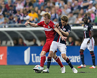 Foxborough, Massachusetts - June 17, 2017: First half action. In a Major League Soccer (MLS) match, New England Revolution (blue/white) vs Chicago Fire (red), at Gillette Stadium.