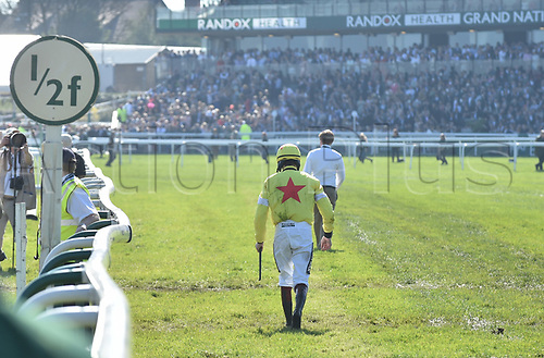 April 8th 2017, Aintree Racecourse, Liverpool, England; Randox Health Grand National Festival Horse racing, Grand National Day; Sam Twiston-Davies walks towards the finishing post after he falls from Politologue at the final fence of the Doom Bar Maghull Novices Chase