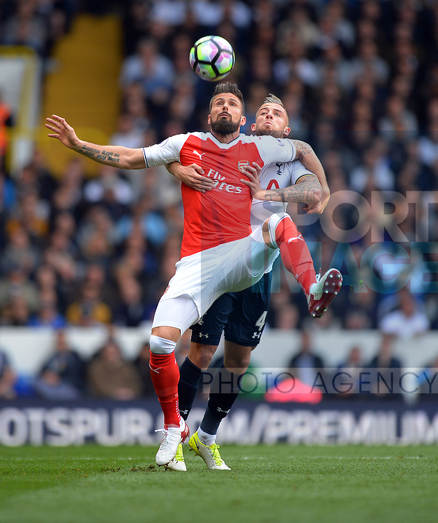 Olivier Giroud of Arsenal is challenged by Toby Alderweireld of Tottenham Hotspur during the English Premier League match at the White Hart Lane Stadium, London. Picture date: April 30th, 2017.Pic credit should read: Robin Parker/Sportimage