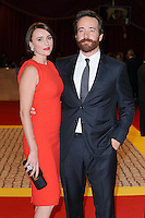 Keeley Hawes & Matthew Macfadyen.The World Premiere of 'The Three Musketeers 3D' at the Vue Cinema, Westfield, London, England..October 4th, 2011.half 3/4 length red orange sleeveless dress clutch bag silver pink shoes black suit beard facial hair married husband wife .CAP/BEL.©Tom Belcher/Capital Pictures.
