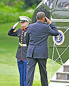 Washington, D.C. - May 17, 2009 -- United States President Barack Obama salutes the Marine Guard as he boards Marine 1 prior to his departure from the South Lawn of the White House in Washington, D.C. on Sunday, May 17, 2009.  The President is scheduled to deliver the commencement address at Notre Dame University in South Bend, Indiana and a Democratic Fund raiser in Indianapolis, Indiana before returning to Washington in the evening..Credit: Ron Sachs / CNP