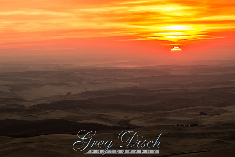Sunset in the Palouse area of Washington State, photographed from Steptoe Butte which rises about a 1000 feet above the surrounding countryside.