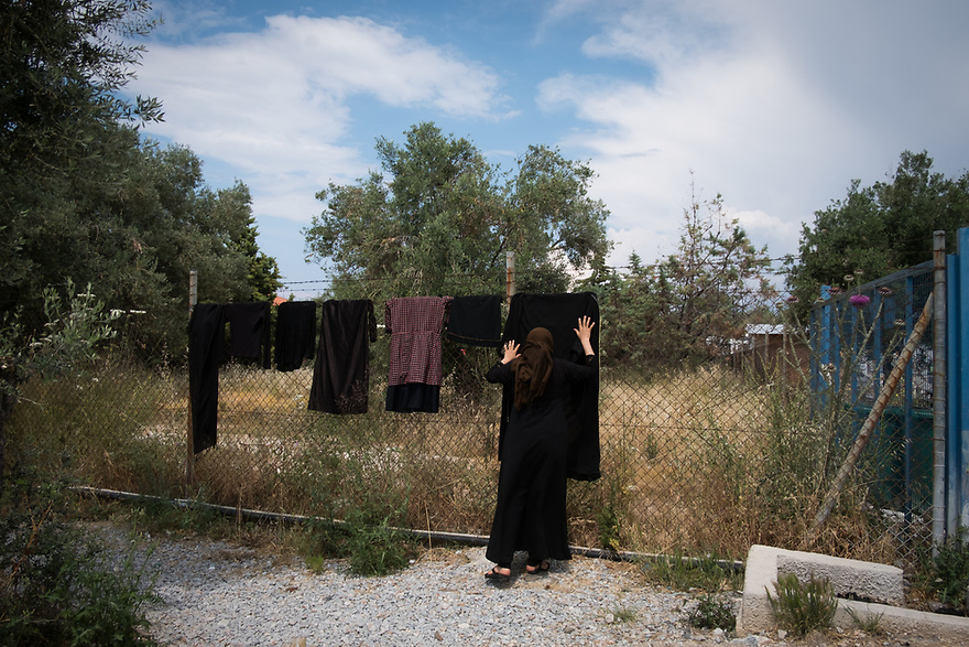 Mitch Moffit and Greg Brown, creators of ASAP Science YouTube Channel visit Kara Tepe Site on the Greek island of Lesvos, where hundreds of refugees are accommodated as they wait to their procedure. Refugee woman hanging laundry.