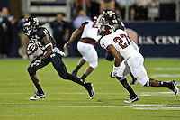 25 October 2011:  FIU wide receiver Glenn Coleman (10) attempts to evade Troy defensive back D.J. Jones (27) after pulling in a reception in the first quarter as the FIU Golden Panthers defeated the Troy University Trojans, 23-20 in overtime, at FIU Stadium in Miami, Florida.