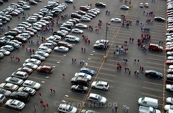 Parking lot and people coming to game at Rice-Eccles Stadium, University of Utah vs. Utah State University college football.<br />