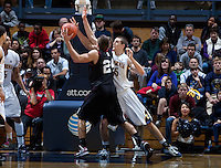 December 29th, 2012: California's David Kravish defends Harvard's Jonah Travis during a game at Haas Pavilion in Berkeley, Ca Harvard defeated California 67 - 62