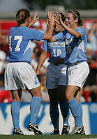 OCT 2, 2005: College Park, MD, USA:  UNC Tarheel forward #20 Heather O'Reilly celebrates her unassisted goal with teammates while playing the Maryland Terrapins at Ludwig Field.  UNC won, 4-0. Mandatory Credit: Photo By Brad Smith (c) Copyright 2005 Brad Smith