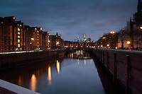 Night lights on the waterways of the Speicherstadt old town. Customs houses, warehouse and dock areas of Hamburg, Germany.