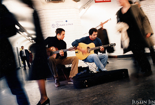 Musicians play in the Bastille metro station of Paris. .Picture taken 2005 by Justin Jin