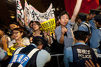Police attempt crowd control at a protest against the revision of article 9 of the Japanese Constitution outside the Prime-Minister's house in Kasumigasaki, Tokyo, Japan. Monday June 30th 2014. Over 10,000 people showed their support for Japan's unique peace constitution and called on the government to halt its reinterpretation of Article 9 allowing Collect Self Defence which is expected to become law on July 1st