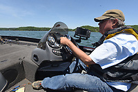 NWA Democrat-Gazette/FLIP PUTTHOFF <br /> Glenn moves May 16 2019 to another of his favorite fishing spots. He tried several during a morning on Beaver Lake.