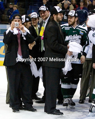 Kurt Kivisto (Michigan State - Milford, MI) snaps some memories as NAME, NAME, NAME, Rob Woodward, NAME, and NAME celebrate. The Michigan State Spartans defeated the Boston College Eagles 3-1 (EN) to win the national championship in the final game of the 2007 Frozen Four at the Scottrade Center in St. Louis, Missouri on Saturday, April 7, 2007.