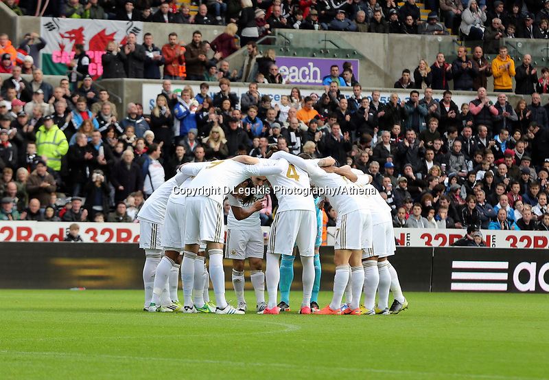 Sunday, 25 November 2012<br /> Pictured: Swansea players huddle before kick off.<br /> Re: Barclays Premier League, Swansea City FC v Liverpool at the Liberty Stadium, south Wales.
