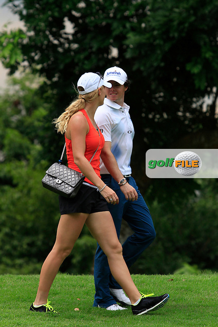 Rory McIlroy (NIR) chats to girlfriend Caroline Wozniacki on the 3rd fairway as Play is suspended due to storm warnings  during Round 2 of the Barclays Singapore Open, Sentosa Golf Club, Singapore. 9/11/12..Photo www.golffile.ie