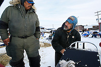 Volunteer checker, Arnold Hamilton , of Shageluk helps Mike Williams fix a broken part of his sled at the Shageluk checkpoint Saturday morning    Iditarod 2009