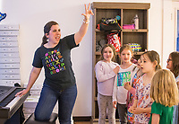 NWA Democrat-Gazette/BEN GOFF @NWABENGOFF<br /> Students learn a song with Rachel Bland, Wingate teaching artist, Tuesday, March 19, 2019, during the 'Broadway in Bentonville' spring break day camp at Trike Theatre in Bentonville. Kindergarten through 6th grade students develop their acting, singing and dancing skills studying a popular Broadway musical each day of the camp.