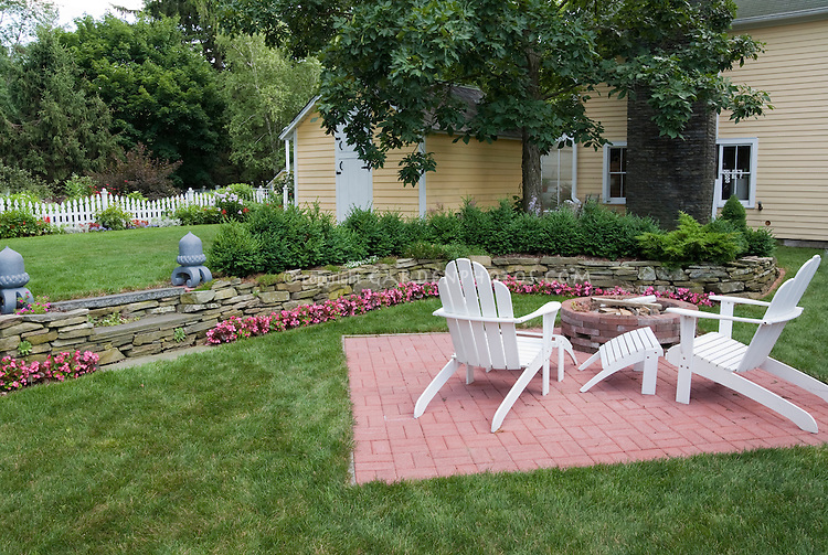 Awesome Brick Patio In Lawn Grass With Adirondack White Wooden Furniture Chairs,  Yellow House, Stone