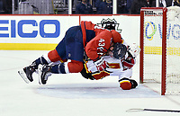 Washington Capitals right wing Tom Wilson (43) takes down Calgary Flames defenseman Rasmus Andersson (4) in the goal crease at the end of an end of game fight after the Calgary Flames vs. the Washington Capitals NHL game on February 1, 2019 at Capital One Arena in Washington, D.C..