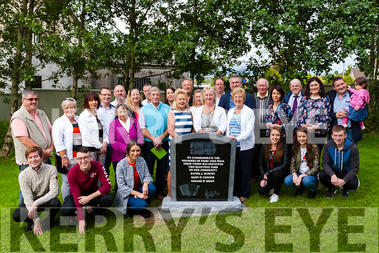 The Murphy. O' Connor & O' Brien families standing alongside the plaque which is dedicated to three of the Town Park's founding members, Dan Murphy, Mary O' Connor & Gerard O' Brien.