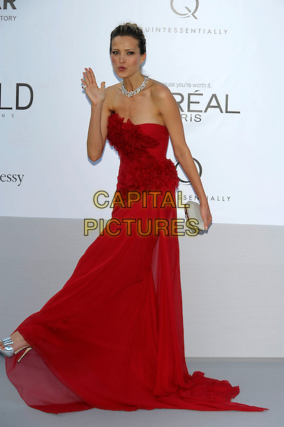 Petra Nemcova.AmFAR Cinema Against AIDS 2012, Hotel du Cap, Antibes during the 65th  Cannes Film Festival, France..24th May 2012.full length red strapless dress ruffle hand blowing kiss leg foot clutch bag grey gray.CAP/PL.©Phil Loftus/Capital Pictures.