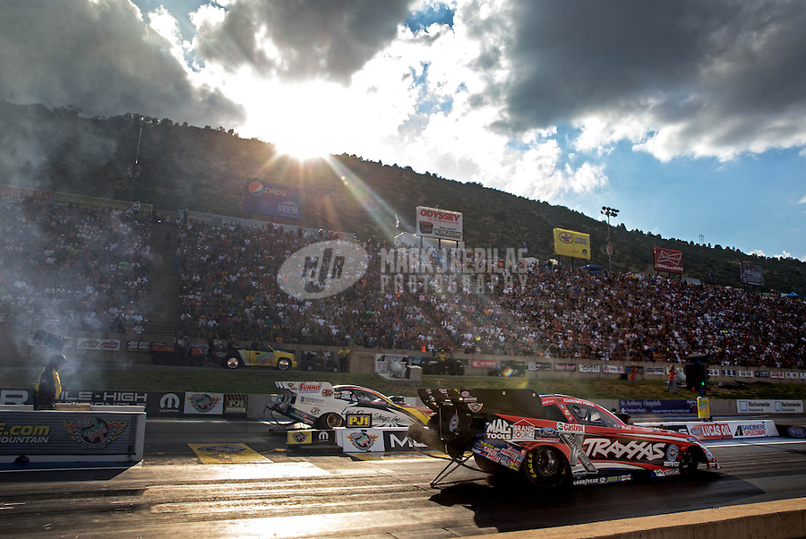 Jul. 19, 2013; Morrison, CO, USA: NHRA funny car driver Courtney Force during qualifying for the Mile High Nationals at Bandimere Speedway. Mandatory Credit: Mark J. Rebilas-