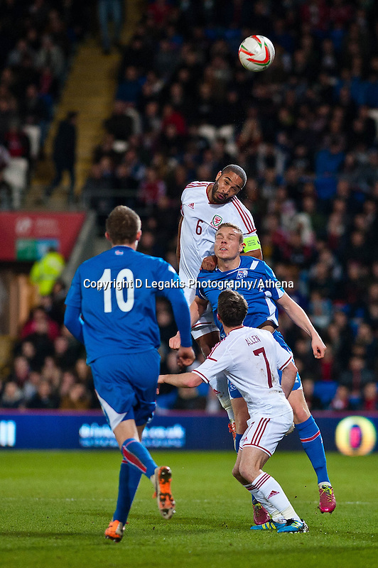 Wednesday 05 March 2014<br /> Pictured: Ashley Williams ( centre ) jumps high for the ball <br /> Re: International friendly Wales v Iceland at the Cardiff City Stadium, Cardiff,Wales UK