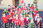 DIVIDED LOYALTIES: Pupils and staff of Knockaclarig national school on the Cork-Kerry border show their colours ahead of the big match on Sunday, with principal Thomas Roche.
