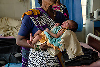 A woman holds a new born baby at the Medak District Hospital in Medak, Telangana, India.