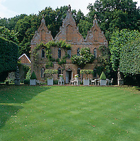 The red brick Jacobean-Revival facade was added in 1720 transforming the hunting lodge into a folly.