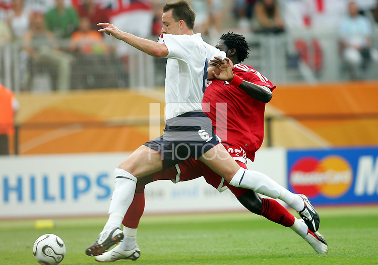 John Terry of England streches to get the ball before Kenwyne Jones of Trinidad. England defeated Trinidad & Tobago 2-0 in their FIFA World Cup group B match at Franken-Stadion, Nuremberg, Germany, June 15 2006.