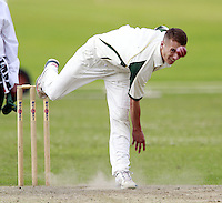 Joe Burke bowls for North London during the Middlesex County Cricket League Division Three game between Highgate and North London at Park Road, Crouch End on Sat July 12, 2014