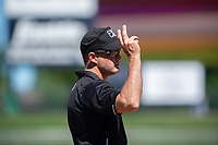 Third base umpire Kyle Wallace signals toward home on May 19, 2019, at Arvest Ballpark in Springdale, Arkansas. (Jason Ivester/Four Seam Images)