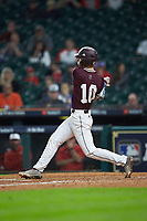 Josh Hatcher (10) of the Mississippi State Bulldogs follows through on his swing against the Louisiana Ragin' Cajuns in game three of the 2018 Shriners Hospitals for Children College Classic at Minute Maid Park on March 2, 2018 in Houston, Texas.  The Bulldogs defeated the Ragin' Cajuns 3-1.   (Brian Westerholt/Four Seam Images)