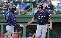 Infielder Elmer Reyes (7) of the Rome Braves, left, is congratulated by teammate Cory Brownsten (30) after Reyes' home run drove in Borwnsten in a game against the Greenville Drive on May 6, 2012, at Fluor Field at the West End in Greenville, South Carolina. Greenville won, 11-3. (Tom Priddy/Four Seam Images).