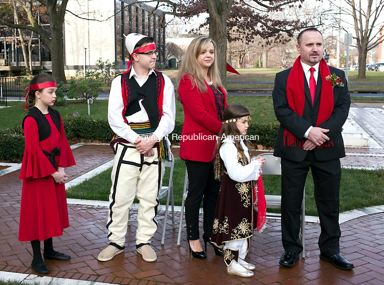 Waterbury, CT- 27 November 2015-112715CM02-  From left, Edina Dani, 12, Neim Dani, 14, and Eliana Dani, 6, stand with their parents,  Admire, back left, and Waterbury Albanian Mayor of the Day, Xhemal Dani, before the annual Mayor for the Day ceremony at the Waterbury City Hall on Friday. The ceremony honored Xhemal Dani, who was born in Dollogozhda, Macedonia and migrated to Waterbury in 1999. Dani is an active member of the Albanian American Cultural Islamic Center Hasan Prishtina, and has helped develop new programs for youth including schools in Albanian language and dance. Dani also helped organize the Labor Day Weekend Albanian Festival.     Christopher Massa Republican-American