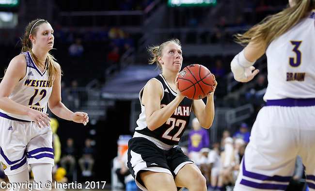SIOUX FALLS, SD: MARCH 6: Mikaela Shaw #22 of Omaha readies a shot between Western Illinois defenders Morgan Blumer #12 and Olivia Braun #3 during the Summit League Basketball Championship on March 6, 2017 at the Denny Sanford Premier Center in Sioux Falls, SD. (Photo by Dick Carlson/Inertia)