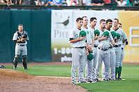 Clinton LumberKings pitchers Jeremy Dobbs #39, David Colvin #28, Kyle Hunter #32, Stephen Shackleford #34, Josh Corrales #10, Matt Brazis #47, and John Taylor #17 line up for the national anthem with catcher Michael Dowd in the background before a Midwest League game against the Kane County Cougars at Fifth Third Ballpark on August 16, 2012 in Geneva, Illinois.  Kane County defeated Clinton 5-3.  (Mike Janes/Four Seam Images)