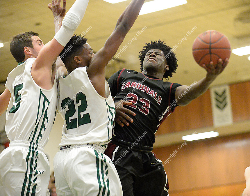 Middleton's Myron Ashford Jr. tries to shoot over the block of Memoria's Chris Knight (22) and Jake Ferguson during the second half of the Big Eight Conference boys basketball game between Middleton and Madison Memorial on Thursday at Memorial High School in Madison